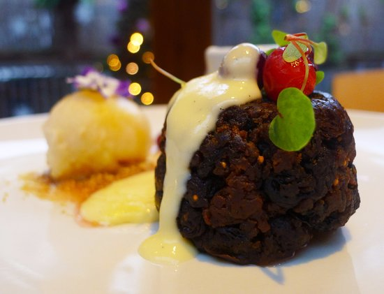 terre a terre delicious figgy pudding sticky with rumtopf fruits and clove custard