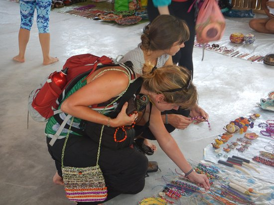 Amazonia Expeditions' Tahuayo Lodge: Tourists selecting from the Artesan collections on Market Day