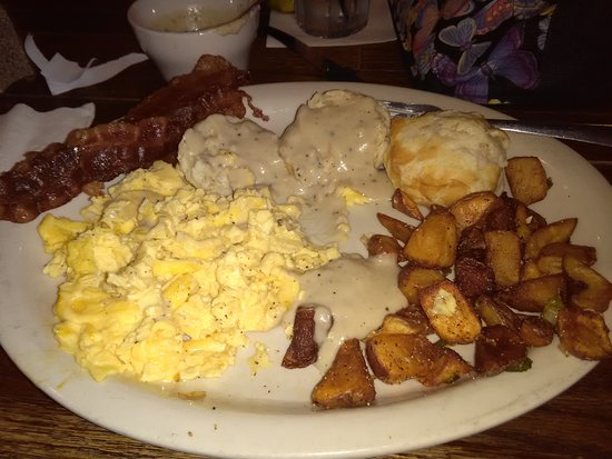 Woodstock, GA: EGGS AND GRAVY BISCUIT ENTREE WITH BACON. SERVED WITH HOME FRIED POTATOES AND FRUIT