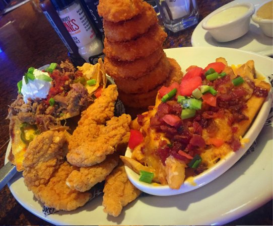 North State Road 7, Boca Raton, FL Want to save on your next order from Smokey Bones Bar & Fire Grill? Here are a few hot tips: first, check Groupon Coupons for the latest deals!Location: North State Road 7, Boca Raton, , FL.