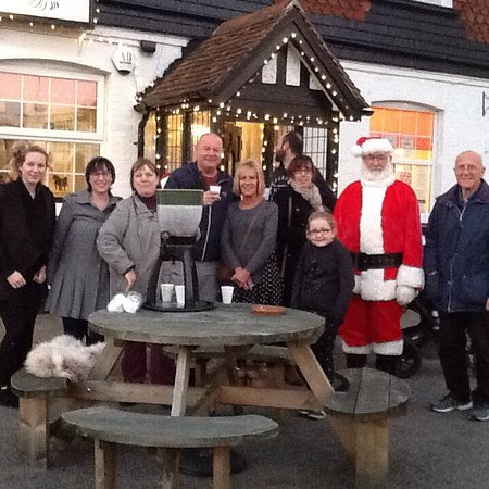 Bexhill-on-Sea, UK: LCCBA Christmas lights switch on, Friday, 3 December 2016, with free mulled wine being served by