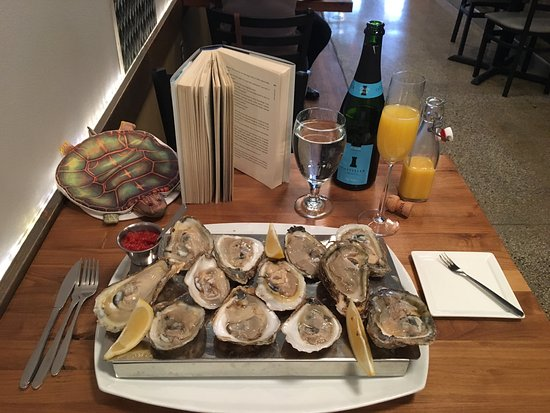 Bloomington, IN : Oysters and Mimosa service for leisurely brunch.
