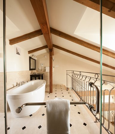 Sewell Junior Suite loft bathroom with soaker tub and separate shower.