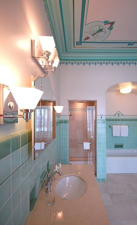 Amyot Junior Suite historic art deco bathroom, with shower and soaker tub.
