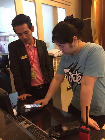Fairtex Sports Club Hotel: Receptionists trying to figure out how to use the card payment machine. They failed.