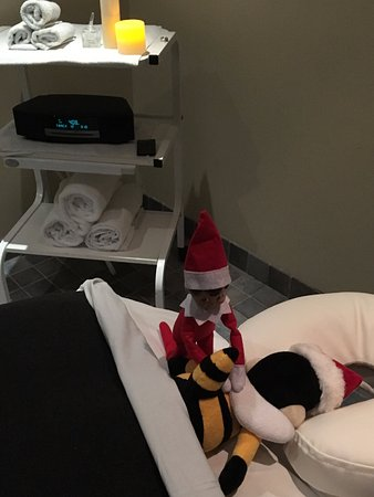 Ottawa, Canada: Our Elf on the Shelf, Jazzy, gives Brookstreet's mini mascot, Buzz, a massage!