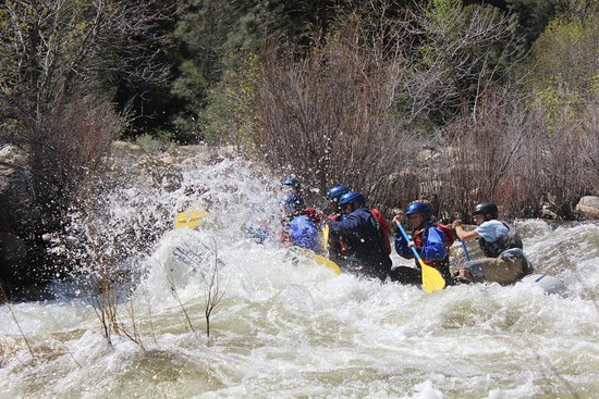 Wofford Heights, CA: A raft smacking a wave at Limestone Rapid on the Upper Kern section near Kernville, CA