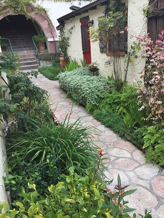 Manzanita Cottages: path to yellow cottage from steep staircase at street level