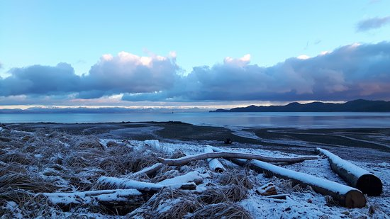 A stunning winter scene of BC's coastal mountain range from Hardy Bay, Port Hardy
