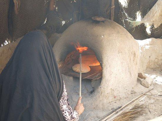 Somerville, MA: Baking bread in a communal oven, village of Mezguida, Southeastern Morocco