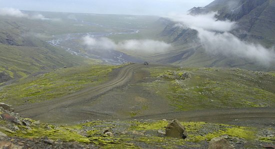 Hofn, Iceland: The ride to the top. The dirt road below is where we will be in a few minutes.
