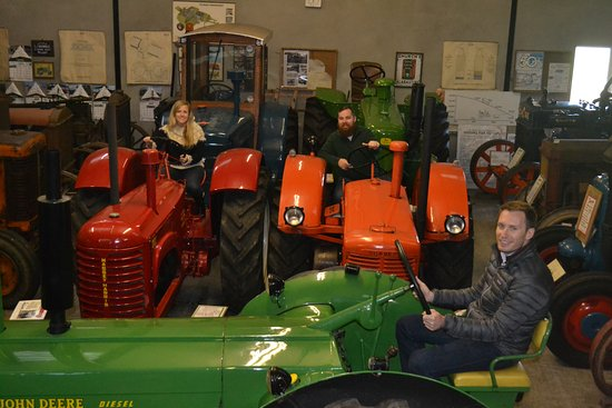 Ballycastle House: Part of Deering tractor collection with guests enjoying a ride.