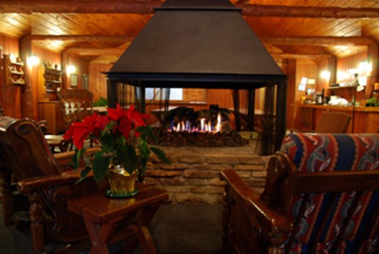 Boyne City, MI: The central fireplace is the focal point of the main lounge.