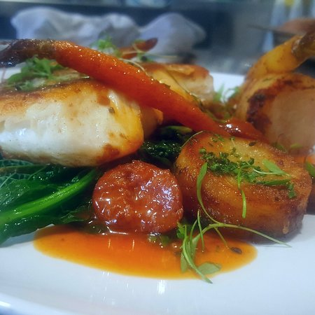 Kennford, UK: Pan roasted Hake, herb potatoes, chorizo butter