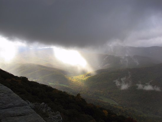 Raven's Roost Overlook: Sunlight bursting through approaching raincloud