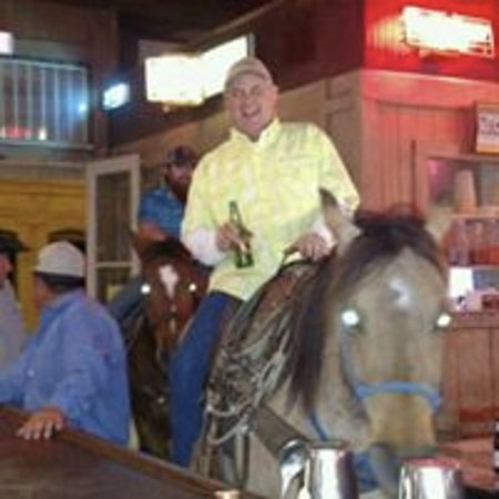 Gonzales, TX: Local cowboy came in to get a drink.