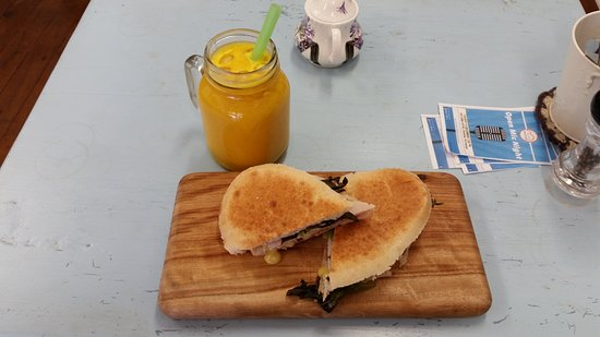Toasted Turkish bread sandwich w/ turkey, cranberry, Brie & leaves and freshly squeezed orange j