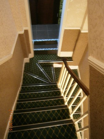 St. Athans Hotel: Looking down to bathroom doorway (2 bathrooms). Note angle turn on steps.