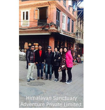 Kathmandu Valley, Nepal: Kerry and her group from Hongkong  with Managing Director Kunjan Chhetri at Bhaktapur Durbar Squ