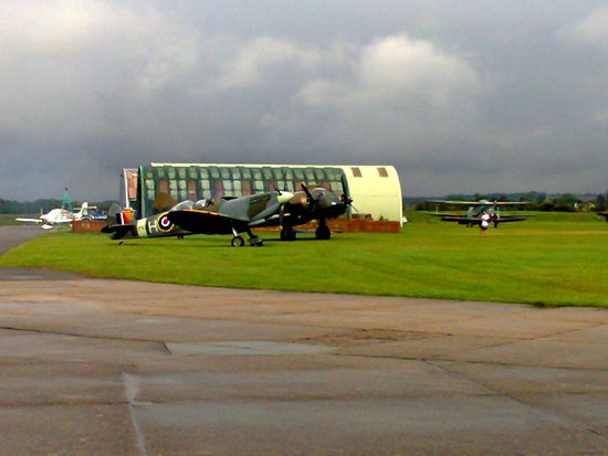 Duxford, UK: Spitfire and others waiting to warm up theit engines