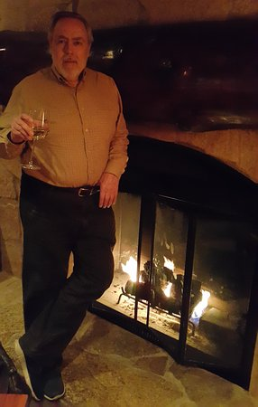 Gleneden Beach, OR: Enjoying a glass of wine warmed by the fire in a cold December night