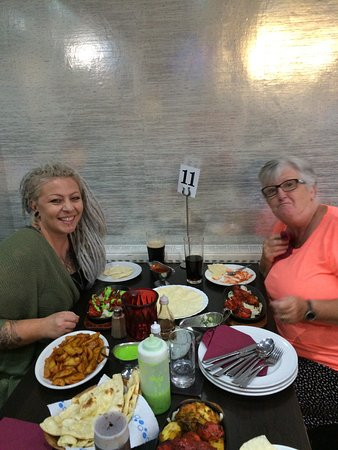 West Bromwich, UK: My friend Ann with her daughter on a visit from Cornwall enjoying the lovely food freshly cooked