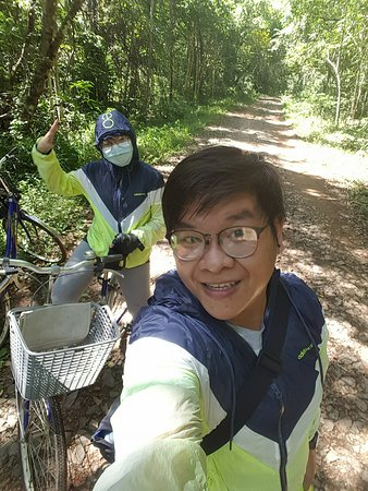 Dong Nai Province, Vietnam: our couple with bicycle journey in the park