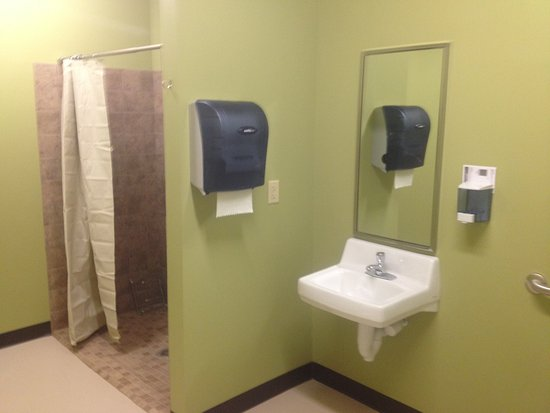Men's restroom with tile shower stall - Picture of River