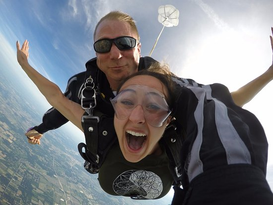 Beloit, WI: Skydiving instructor Howy and first time jumper Gennifer have a grand time during the minute sky