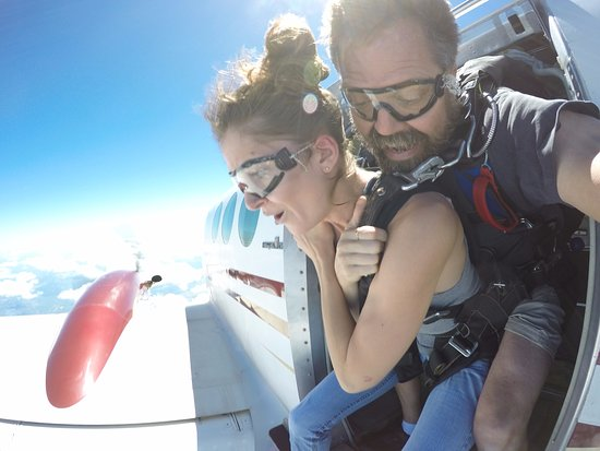 Beloit, WI: Skydiving instructor Eric and first time jumper Samantha exiting at 14,000 feet above the Illino