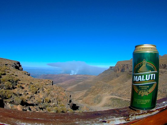 "Sani Pass, เลโซโท: Maluti, the local beer in Lesotho, and the view from on top. Taken at the ""Highest Pub in Africa"