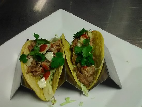 Wenatchee, WA: Pork Tacos w/ melt in your mouth slow roasted Pork. Fresh parmesan shavings, cilantro, red sauce