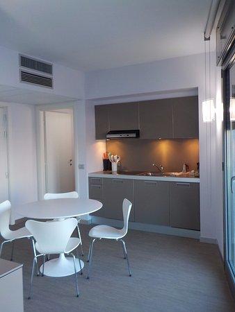 Zona cocina y mesa del apartamento - Picture of Zambala Luxury ...