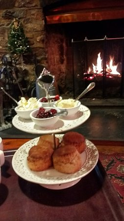Ashburton, UK: Cream tea in front of the log fire.