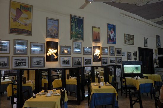 Dining Room With Vintage Aeronautical Wall Sconces Picture