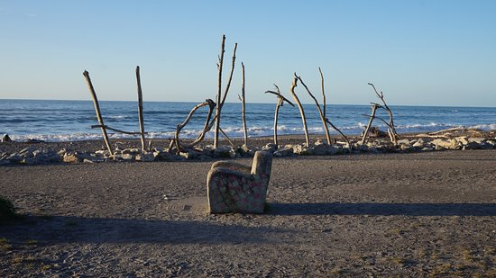 hokitika word made with branches and a chair made of rock facing