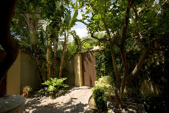 The Andalusian Court: Villa three additional garden area with private parking lot entrance.