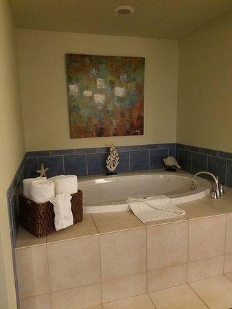 Very nice tub in room.
