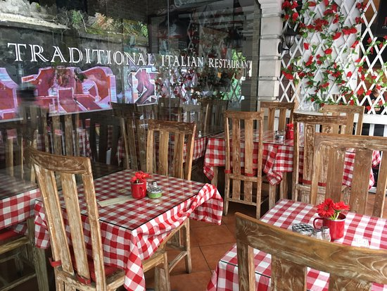 Traditional italian restaurant front window picture of for All about italian cuisine