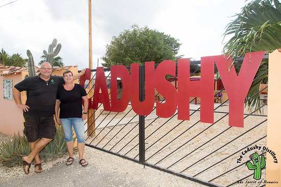 The owners of The Cadushy Distillery in front of the Distillery in the center of Rincon