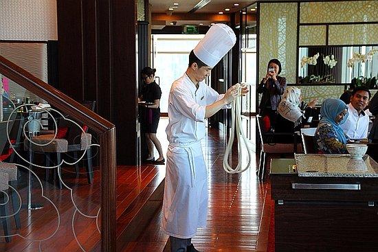 Chef making noodles