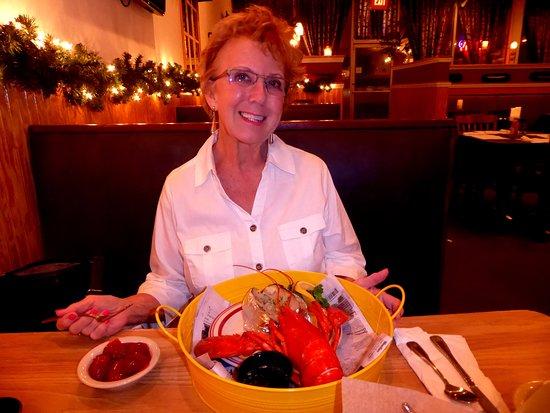 Zephyrhills, ฟลอริด้า: Marsha enjoying her lobster dinner with all the fixin's.