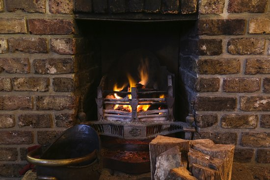 Newgate Street, UK: Open lit fire