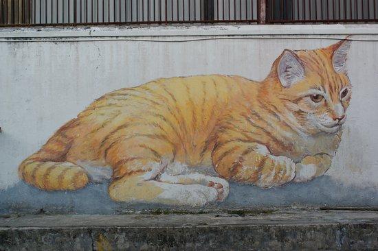 street art in george town yellow cat mural