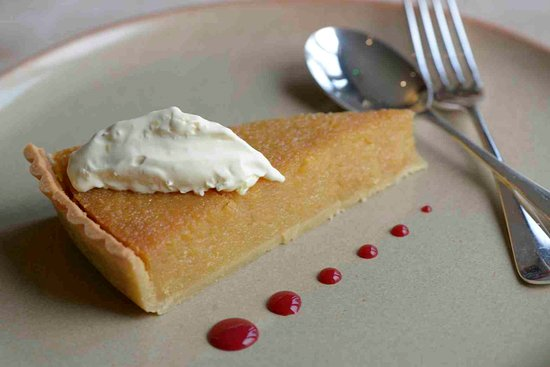 South Molton, UK: Vintage Treacle and lamon tart, coulis and clotted cream