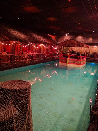 "Tonga Room: Band boat floats to center of ""lake"""