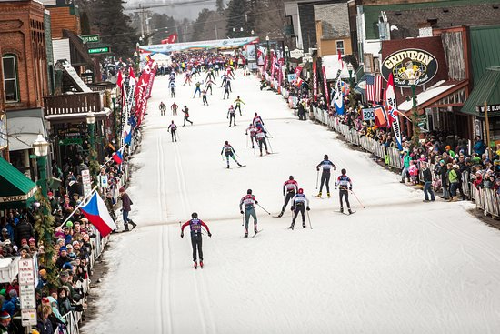 Hayward, WI: Skier's reaching the finish line crossing the Birkie Bridge