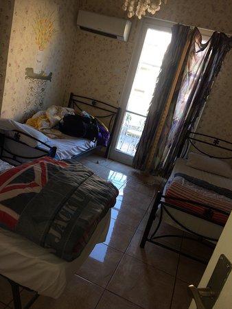Athens House Hostel: 1.reception 2.hallway 3. Bathroom with cold water 5.hallway 6.balcony 7. Room