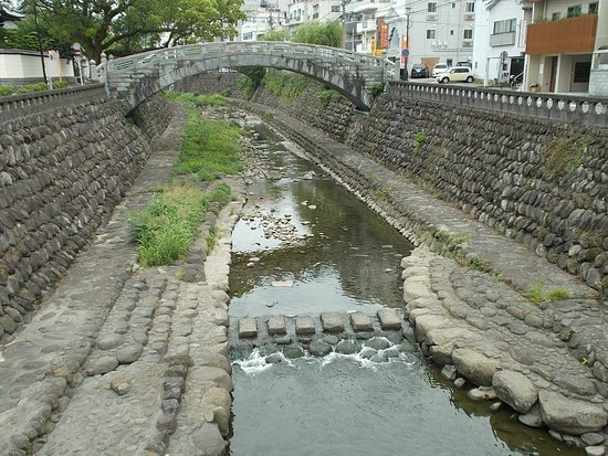 Nagasaki International Hostel Akari: A stone bridge over the river just across the street in front of the Hostel