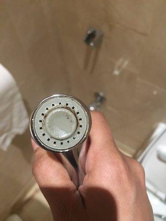 The Meydan Hotel: Disgusting blackish deposit on water faucet in the room bathroom
